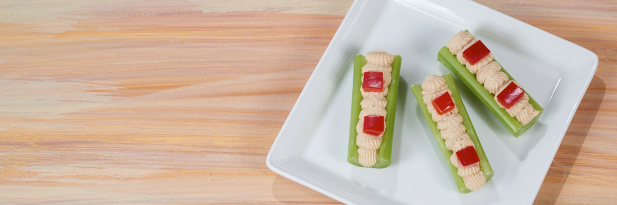 Hummus and Red Pepper Celery Logs